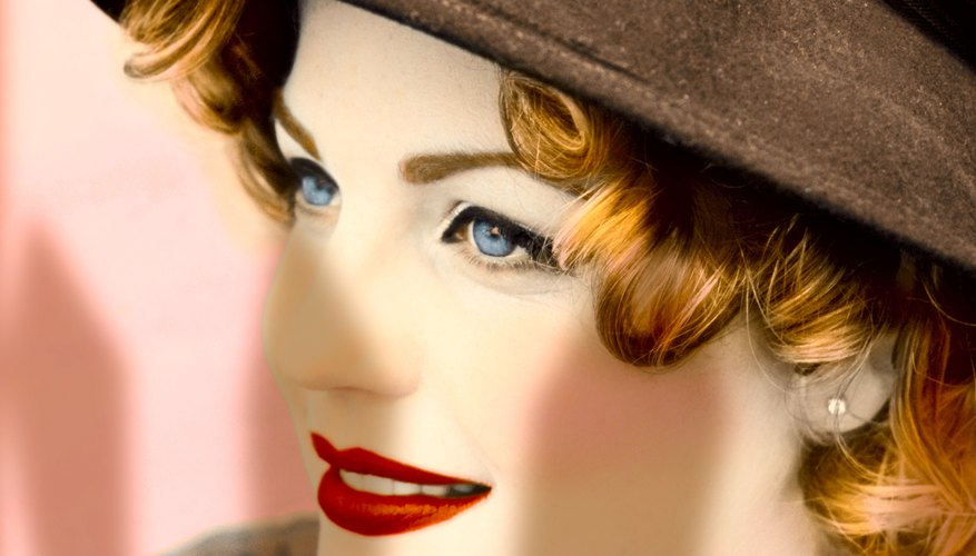Pair a 1950's brimmed hat with a head of playful curls.