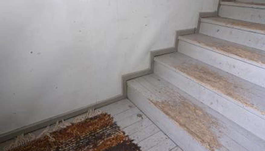 Protecting stairs with carpet involves finishing the edges.