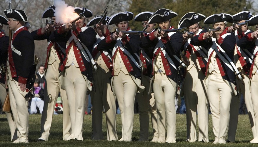 Revolutionary-era soldiers fired their muskets in massed volleys.