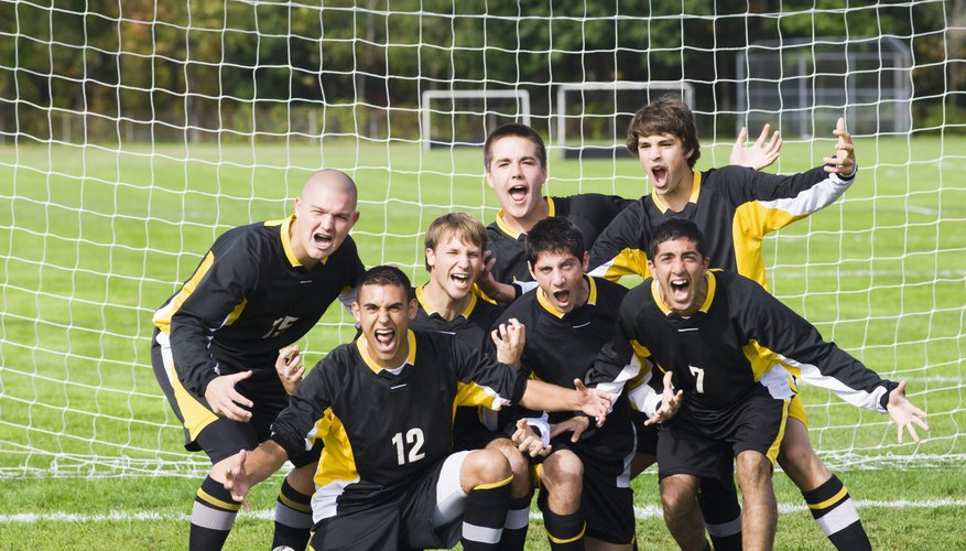 A group of college aged male soccer players.