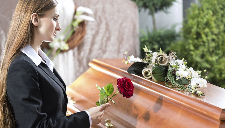 Woman at casket.
