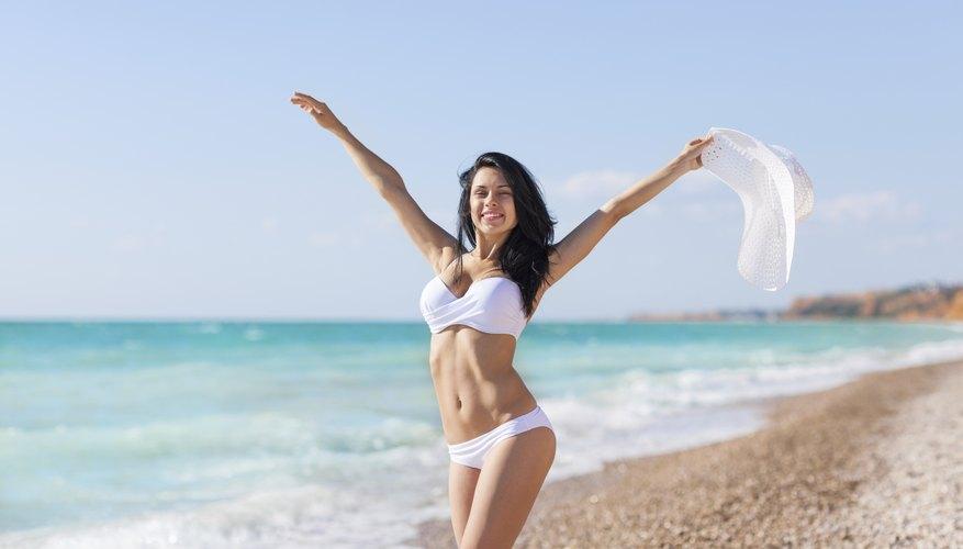 Swimsuit model frolicking on beach