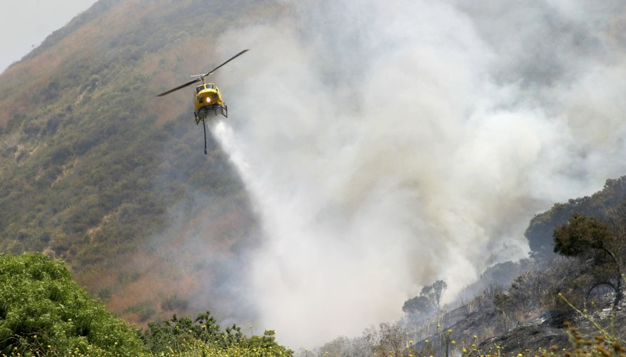 A helicopter fighting a forest fire.