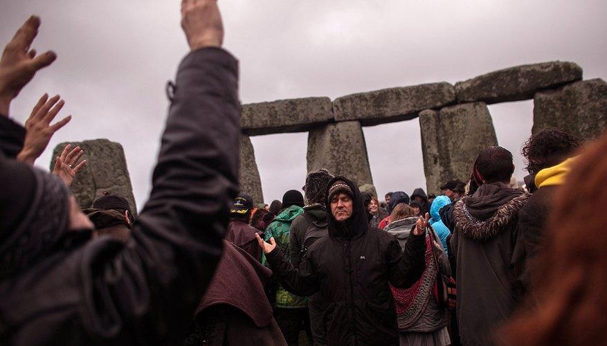 A gathering of pagans celebrating solstice at Stonehenge.