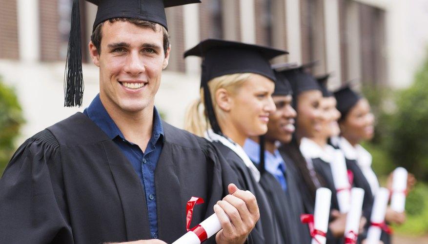 Smiling graduate student holding diploma