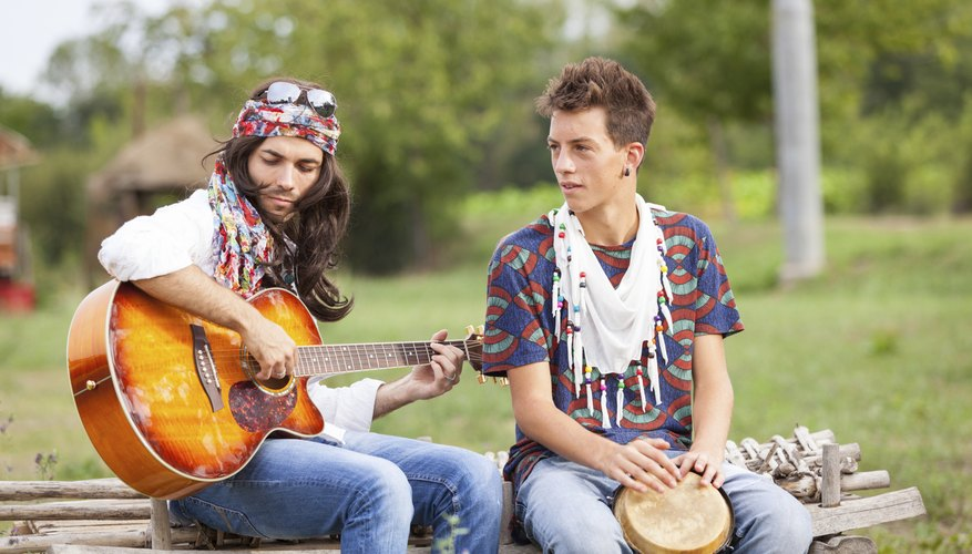 Men playing guitar and bongo drum.