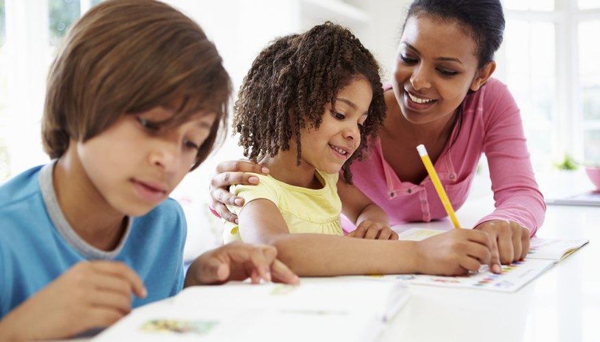 EEC Certified teacher helping elementary students with homework in after-school program