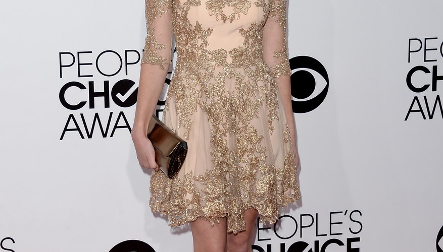Actress Greer Grammer rocks a champagne cocktail dress and sparkling gold heels at the 2014 People's Choice Awards in Los Angeles.
