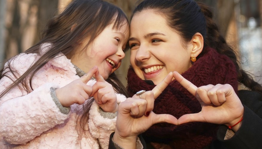 A child with Down syndrome needs reinforcement and support.