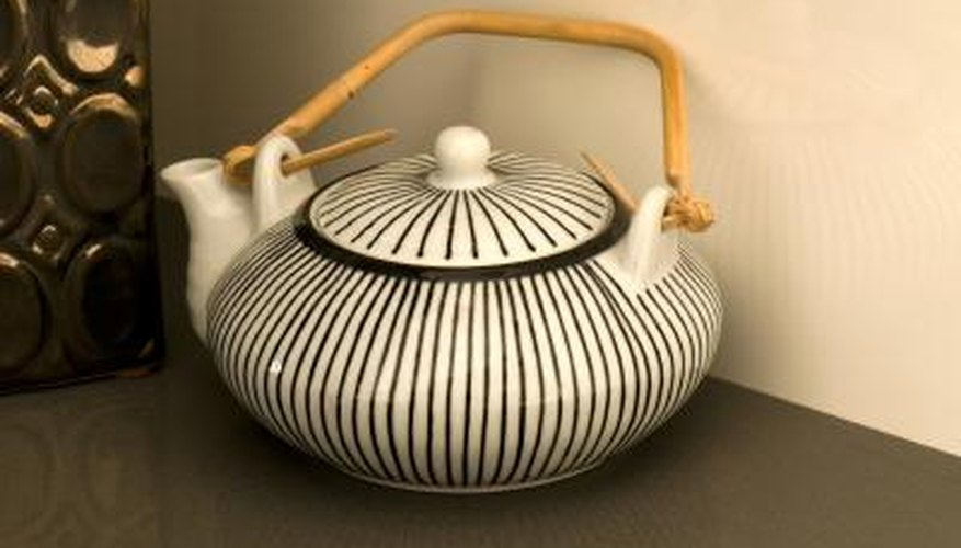 Dress up a plain teapot with a painted pattern.