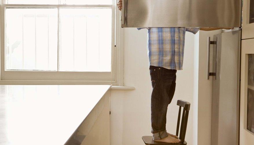 Leaving your freezer door open is part of the defrosting process.