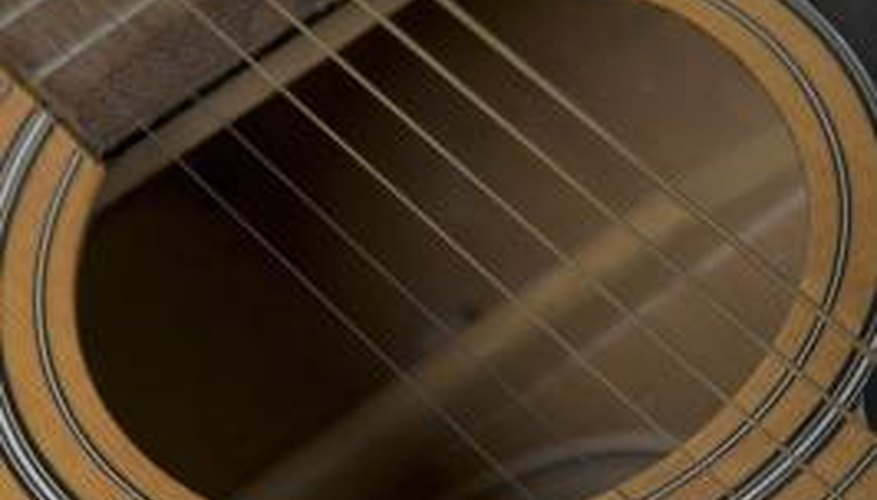 The top and bottom of a guitar are supported by bracing.