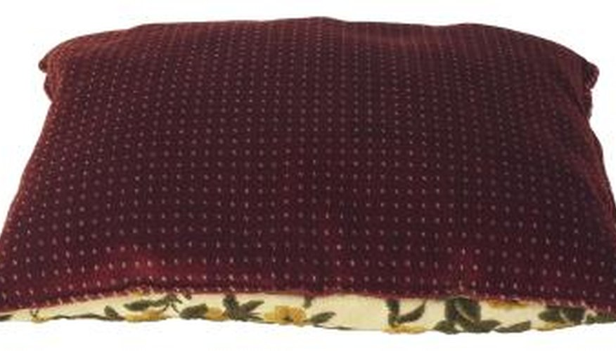 Numerous colours will coordinate well with a burgundy sofa.