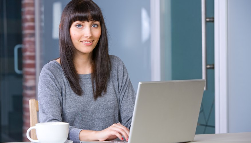 Young woman doing research on laptop