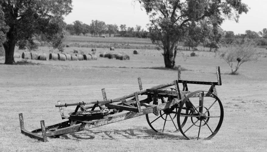 A black and white photo of a farm tool in the late 1800s.