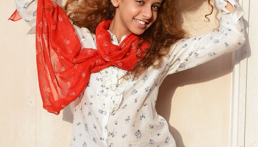 Actress Waad Mohammed rocks a blue-and-white print shirt with a tomato-red scarf in Dubai in 2012.