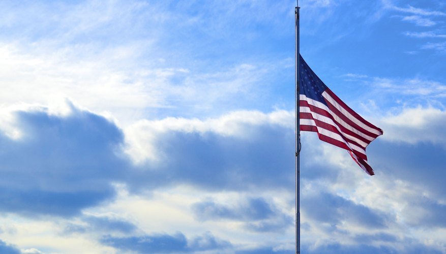 An American flag flying at half mast.