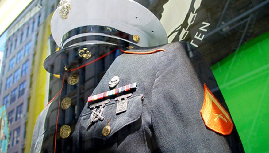 Marine corps uniforms have a distinct red stripe and gold buttons.