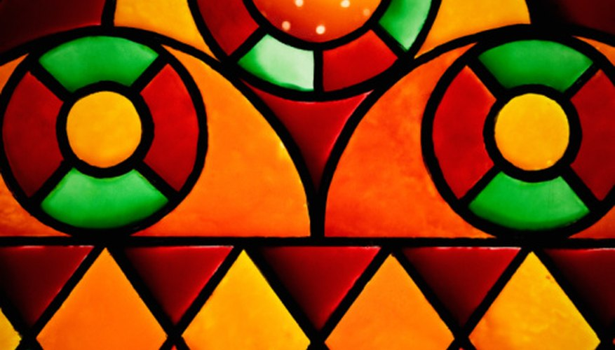 Create a stained-glass look with bits of colored paper and glue.