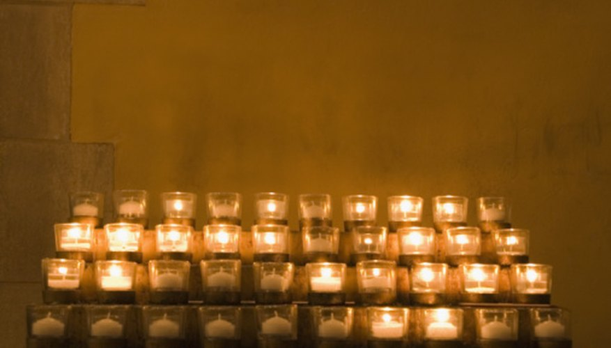 A table of votive candles.