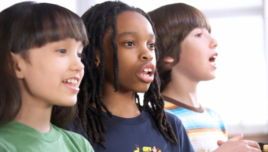 Elementary students enjoy singing together.