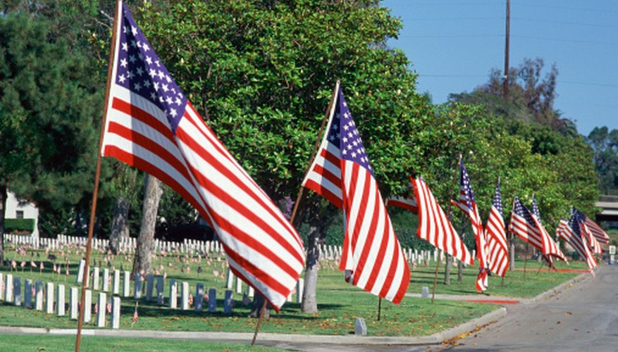 Flags are given positions of honor in military veteran's cemeteries.