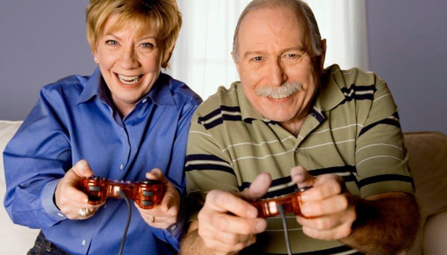 Senior adults enjoy age-appropriate video games.