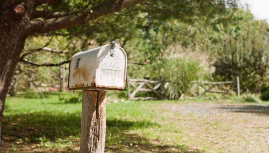 Go to the local post office to change a deceased person's mailing address.