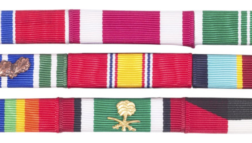 The leftmost ribbon in the second row is a demonstration of the 4th Award of the AAM.