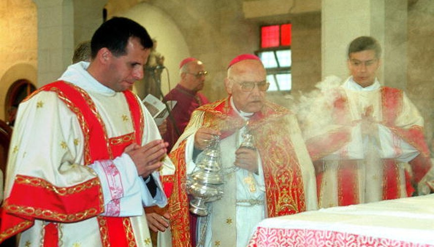 A priest in Bethlehem uses incense to bless the altar.