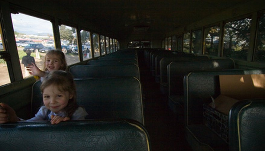 Passengers must all sit while the school bus is in motion.