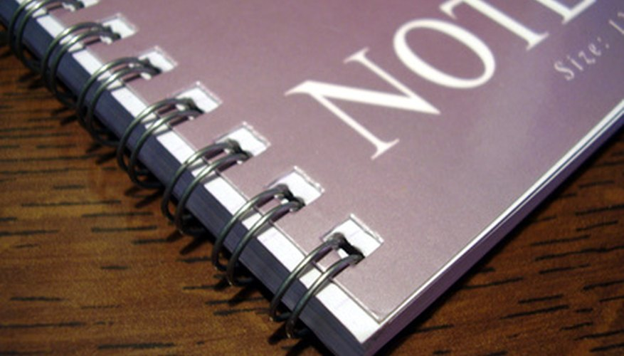 Notebooks with spiral or sewn bindings are strongly preferred over