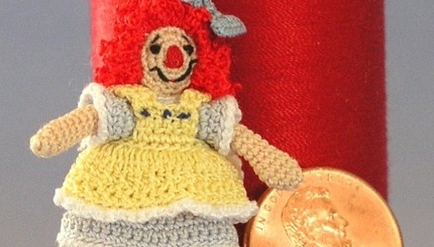 Crocheted doll with crocheted hair.