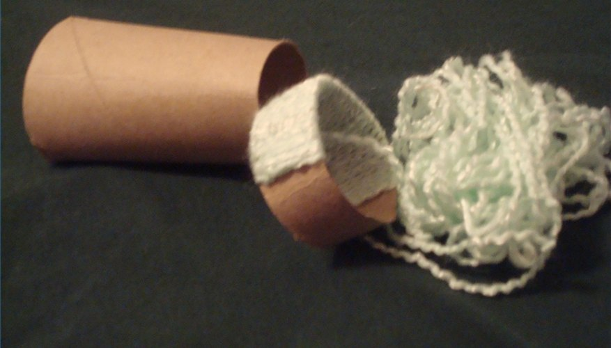 A partially finished yarn and roll napkin ring in the middle