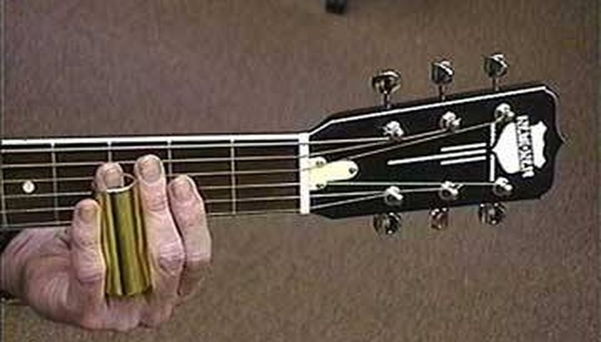 An example of proper slide guitar positioning, using the ring finger.