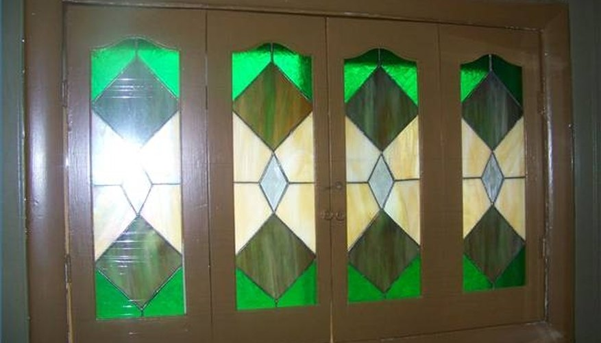 Stained glass window shutters created by Bob Dodrill Sr.