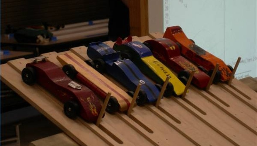 Pinewood Derby cars at the starting line.