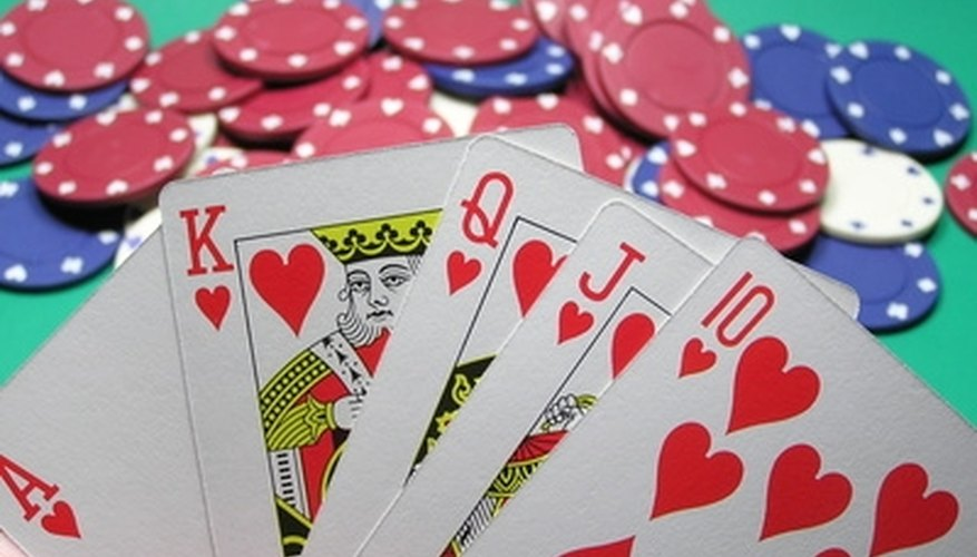 Tripoley is played with cards and chips. Face card hearts are winning cards.