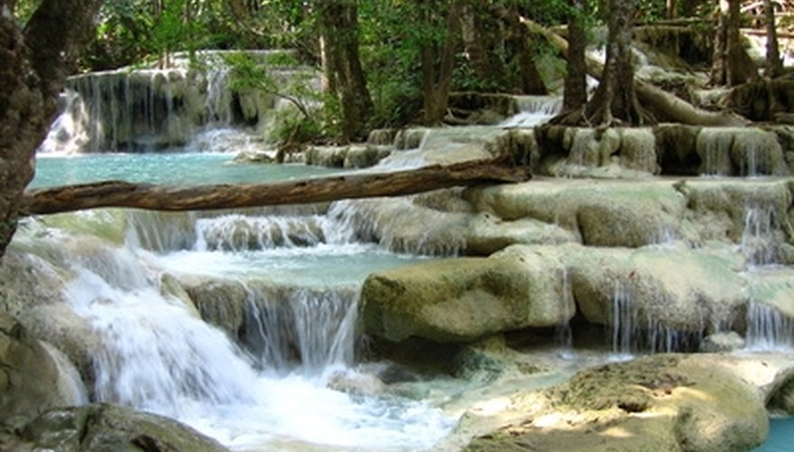 Holding hands walking across the waterfalls is romantic.