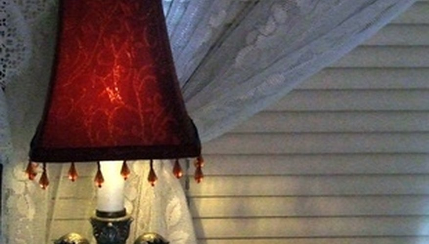 Use lamps to create warm light for romantic bedrooms.