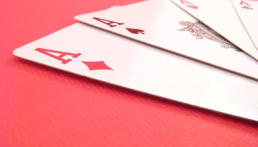 A meld in Canasta is three or more cards of the same kind.