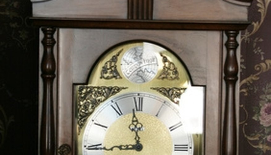 Grandfather clock with encased glass.