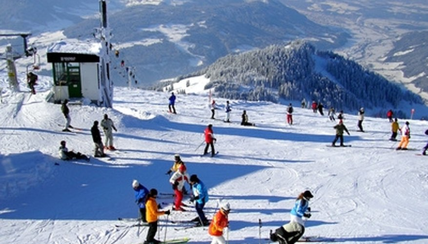 Many couples enjoy partaking in activities together on a romantic vacation, such as skiing.