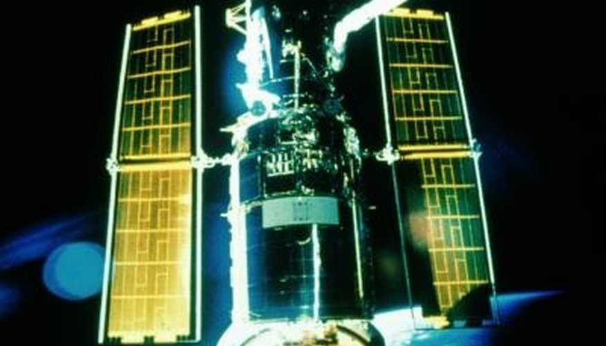 Solar cells power satellites in deep space.