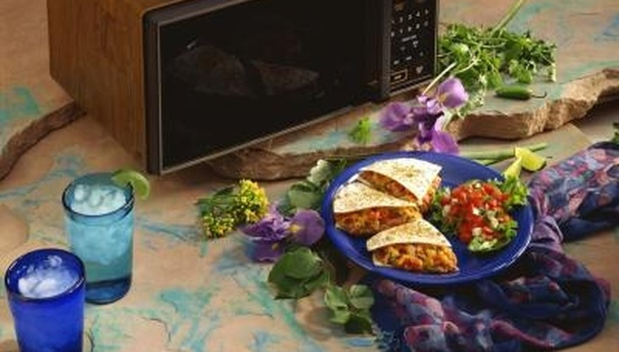The microwave oven makes cooking quick and easy, but may leave behind a greasy mess.