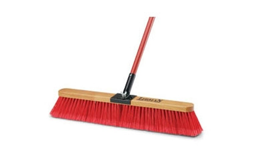Use a push broom like this to distribute the boric acid evenly.