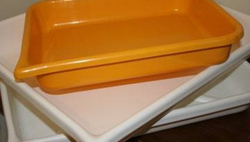 Trays for chemicals to process paper
