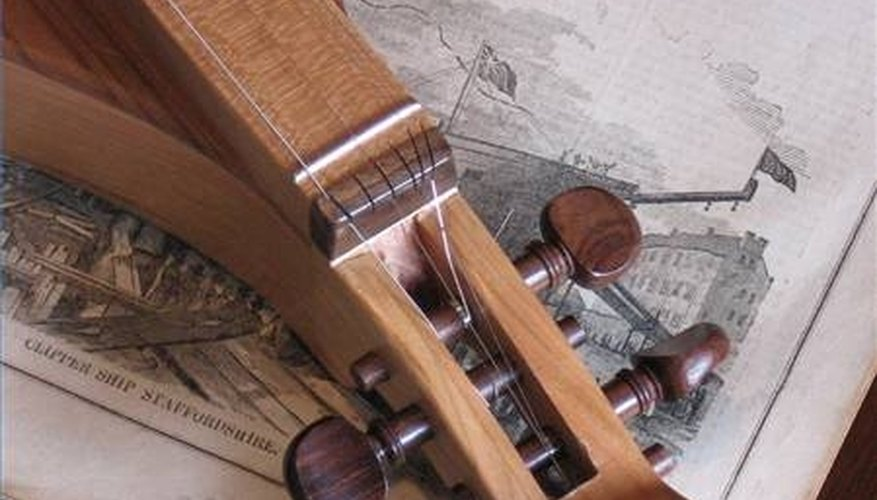 The scroll, pegs, nut, and fretboard of a mountain dulcimer