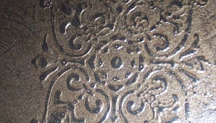 Stencil designs can be added to tray ceilings with plaster or glaze