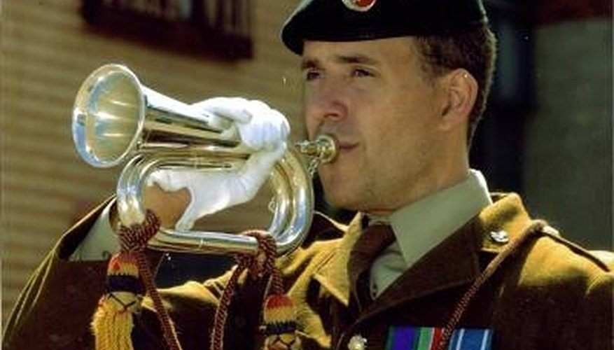 A bugle major plays at a ceremony